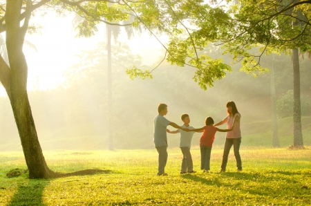a family having fun playing in the early morning Stock Photo