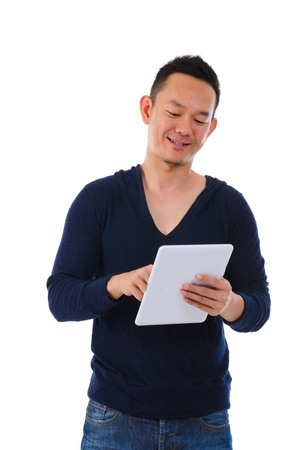 happy asian male on a generic tablet photo