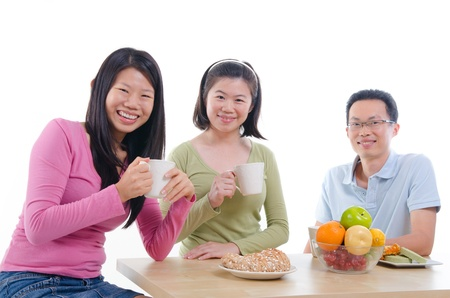 asian family dining with isolated white background photo