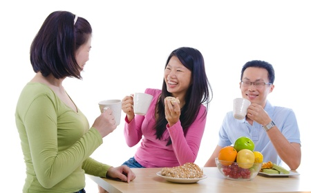 family dining: asian family dining iwht isolate white background Stock Photo