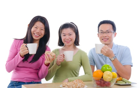 asian family dining iwht isolate white background Stock Photo - 16008916