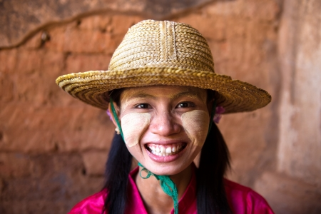 casual myanmar girl with a hat photo