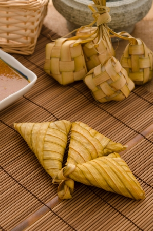 compressed rice: Ketupat: South East Asian rice cakes bundle, often prepared for festivities and celebratory occasions.