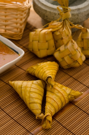 malay food: Ketupat: South East Asian rice cakes bundle, often prepared for festivities and celebratory occasions.