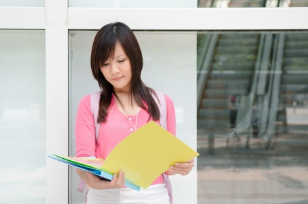 asia young college girl with a folder photo