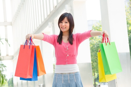 asian girl shopping happily photo