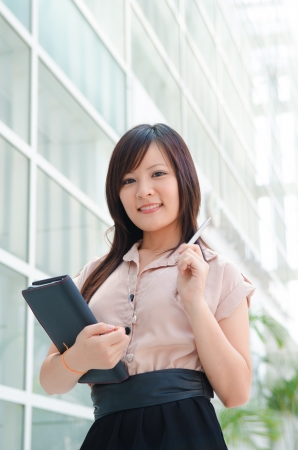 asian business girl with a notebook photo