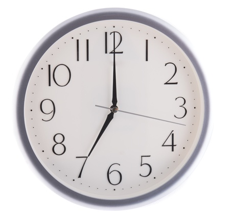 oclock: isolated white clock at seven