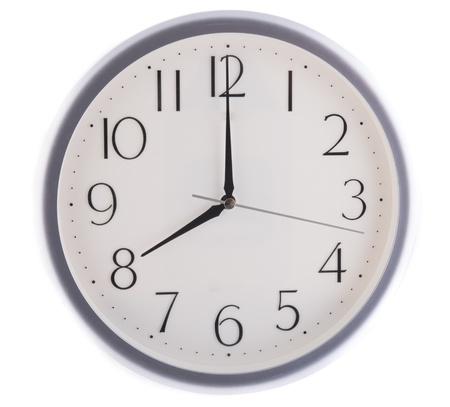 oclock: isolated white clock at eight