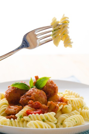 tasty looking spaghetti bolognese with white background   photo