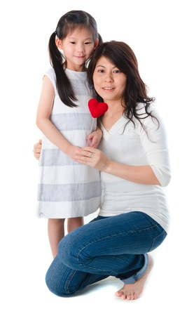 Photo of Asian mother and daughter on white background, full body
