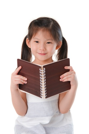 tuition: cute little asian girl reading Stock Photo