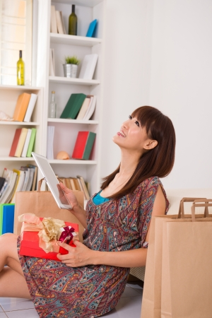 asian girl enjoying online shopping photo