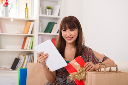 asian girl enjoying online shopping from home Stock Photo - 16252666