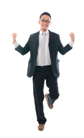 delighted: delighted asian business male jumping in joy  Stock Photo