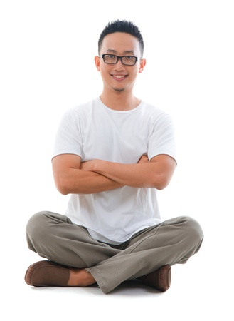 asian casual male sitting, smiling happily  photo