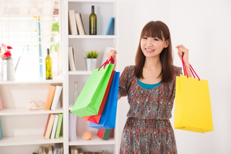 asian girl shopping: asian girl back from shopping