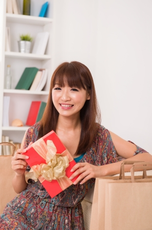 asian girl enjoying online shopping from home  photo