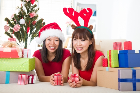exchanging: asian friend lifestyle christmas photo, close up on face Stock Photo
