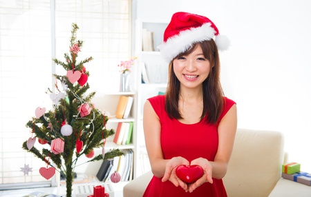 asian girl during christmas with her presents photo