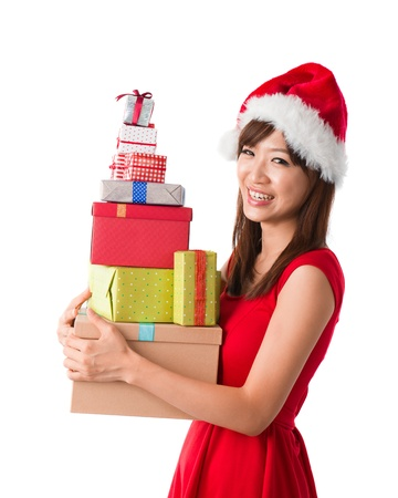 beautiful asian girl with plenty of gifts during christmas Stock Photo - 16323491