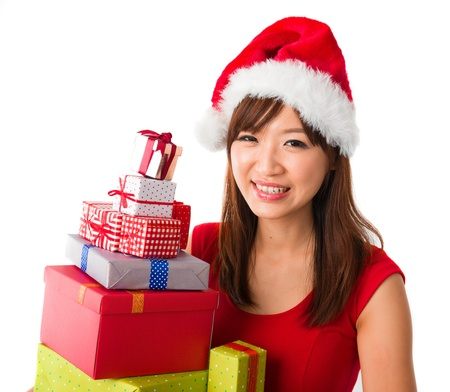 beautiful asian girl with plenty of gifts during christmas photo