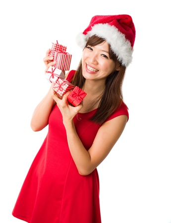 beautiful asian girl with plenty of gifts during christmas, ioslated on white Stock Photo - 16323477