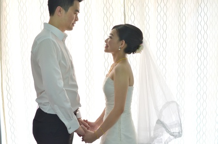 asian wedding: Asian chinese bride and groom on their actual wedding day