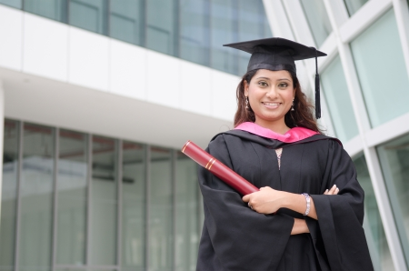 a young indian female graduate during her convocation day. photo