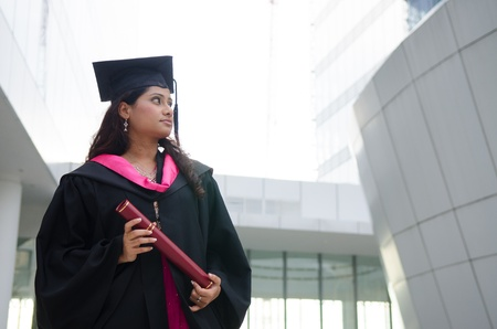 south asian: a young indian female graduate during her convocation day.