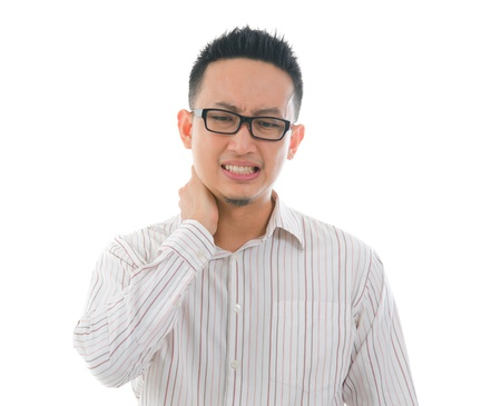 asian male having a bad neck pain photo
