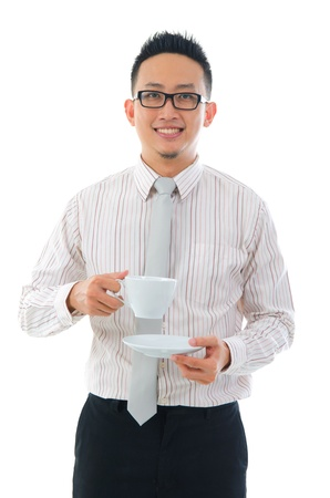 contempory: happy asian business man with coffee