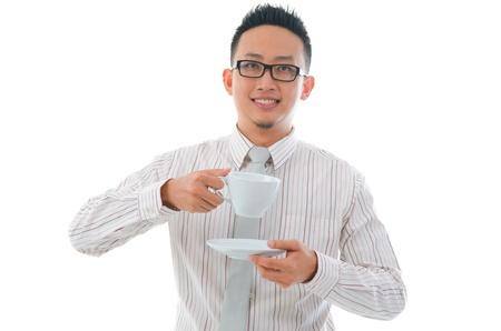 asian man having tea or coffee break