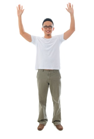 asian male casual raised arm in full body, isolated on white  photo