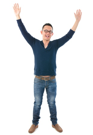 hands raised: casual asia man with hands raised