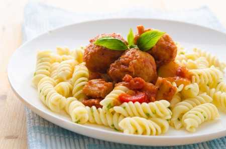 tasty looking spaghetti bolognese, focus on meatballs  photo