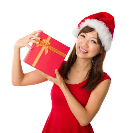 asian girl with a present box during christmas,isolated on white Stock Photo - 16711362