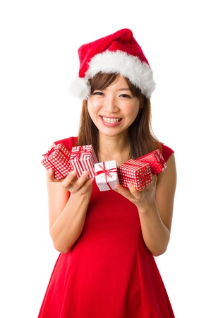beautiful asian girl with plenty of gifts during christmas Stock Photo - 16711319