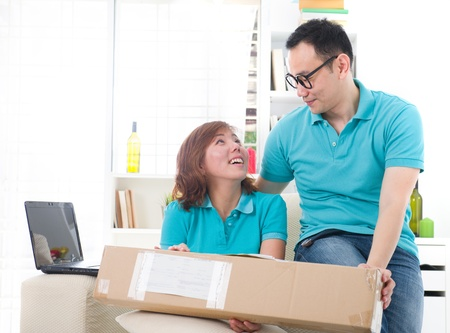 receive: asian couple doing online shopping lifestyle photo