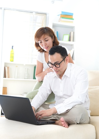 asian couple doing online shopping lifestyle photo photo