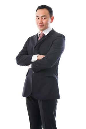 south east asian: al sur este hombre de negocios asi�tico de pie etnia china, atraves� el brazo Foto de archivo