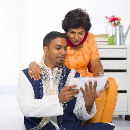 dhoti: indian family lifestyle photo surfing on the Internet, wearing traditional punjabi dress Stock Photo