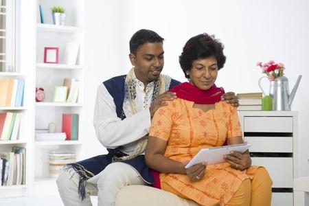 salwar: indian family lifestyle photo surfing on the Internet, wearing traditional punjabi dress Stock Photo
