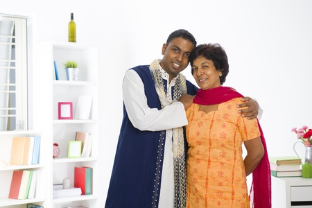 dhoti: indian punjabi mother and son lifestyle photo in traditional dress
