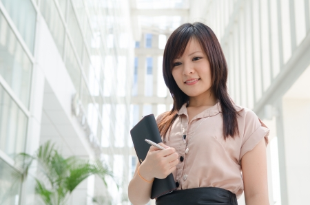 chinese female student in formal wear Stock Photo - 16711321