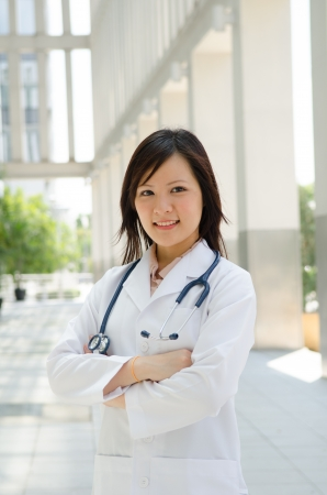 asian medical female student , arms crossed photo