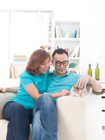 asian couple with cat ,  chinese south east asian ethnicity photo
