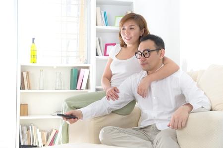 asian couple watching tv lifestyle  photo