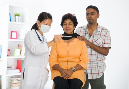 old man on a physical pressure: indian senior doctor appointment medical checkup Stock Photo