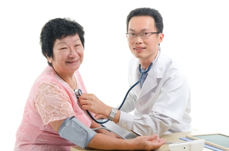 check up: asian senior female medical checkup with doctor heart beat monitoring ,south east asian chinese ethnicity